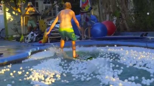 Cached: SKIMMING ACROSS 10,000 PING PONG BALLS!! Challenge